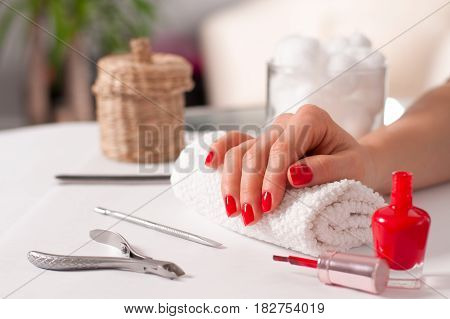 Beautiful Manicure, Woman's Hand With Red Manicure On Nails.