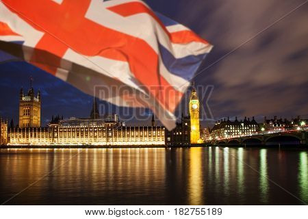 union jack flag and iconic Big Ben at the palace of Westminster, London - the UK prepares for new elections