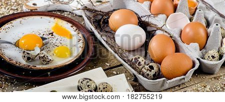 Chicken And Quail Eggs On A Rustic Wooden Background