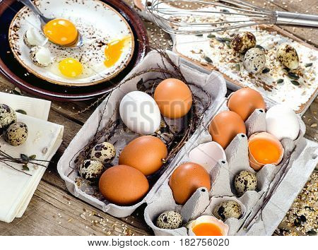 Chicken And Quail Eggs On A Rustic Wooden Background.
