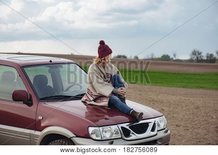 Female driver on off road car.