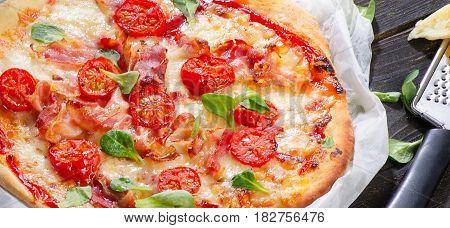 Italian Pizza  On A Dark Wooden Background.