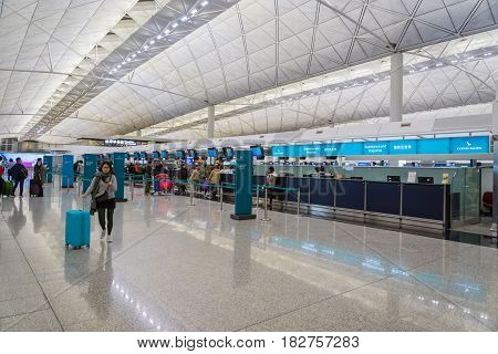 Hong Kong - circa March 2017:  Cathay Pacific check-in counter area inside of Hong Kong International Airport. It is the main airport in Hong Kong. The airport is located on the island of Chek Lap Kok