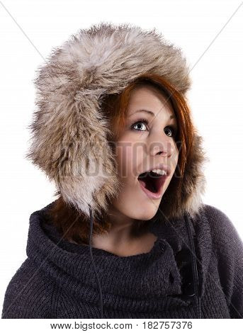Portrait of surprised pretty smiling woman in fur winter hat isolated on white