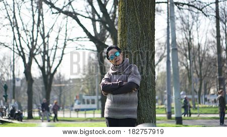 Asian Senior Woman Travel In Europe Taking Potrait In Park