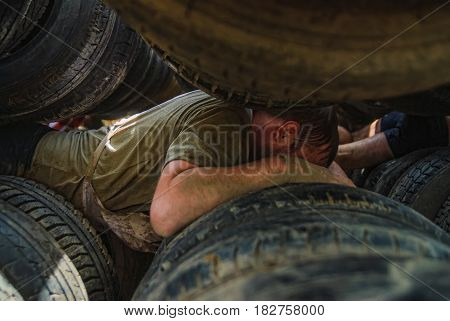 Athlete Moves Between Old Tires. Tyumen