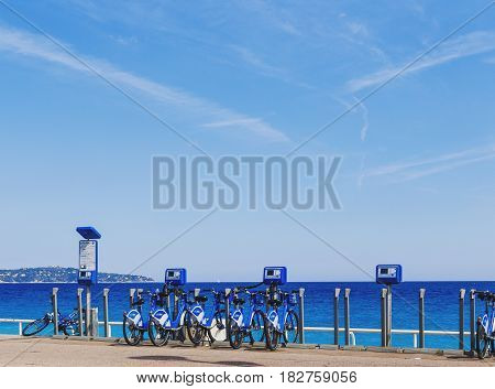 Promenade Des Anglais Seaside In Nice With Blue Bikes