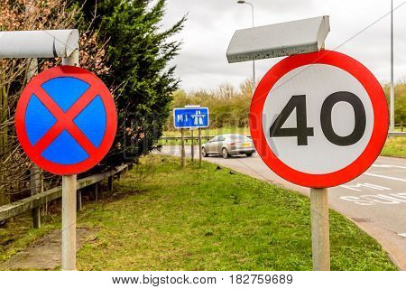 Day view background of UK Motorway Road 40 Speed Limit.