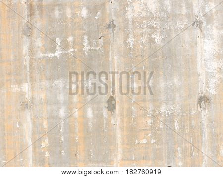 Old light gray concrete wall with a rough surface and yellow streaks