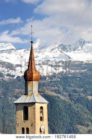 bell tower bulb typical of Savoie with snowy mountain background