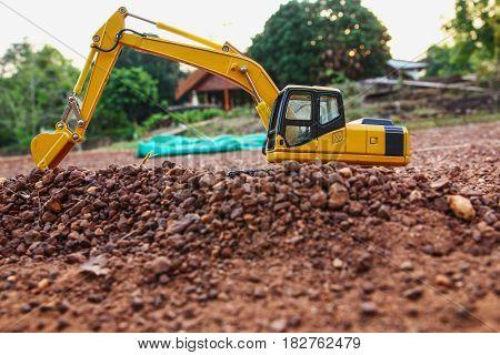Excavator loader model on ground and stone floor
