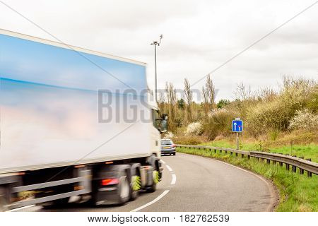 Day view background of UK Motorway Road Sign Lorry Truck.