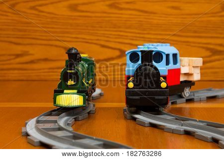 Two Toy Trains On The Gray Rails