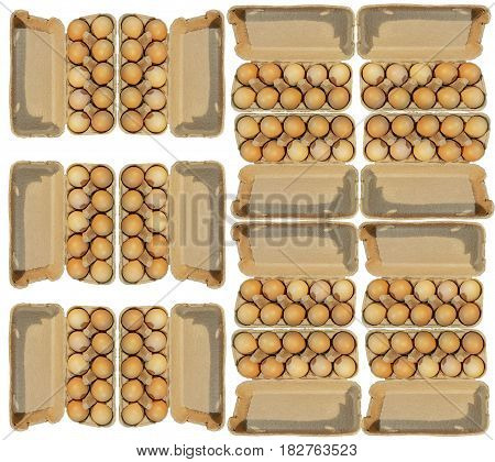 Fourteen carton packages of ten brovn eggs isolated on white