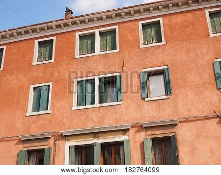 Chioggia, Italy, palace facade. Colors and windows.