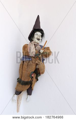 The doll is a witch in old rags. In a hat and flies on a broomstick