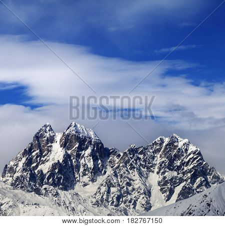 Mounts Ushba And Chatyn And Blue Sky With Clouds