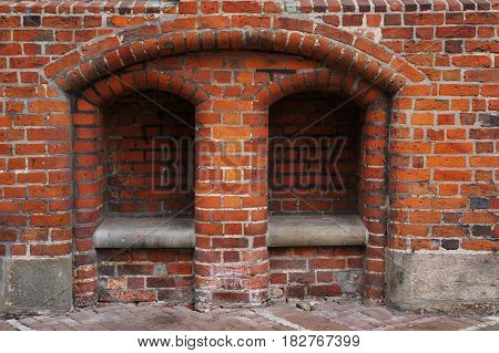 Stone bench in niche of brick wall of Old Town Hall in Hannover, Germany.