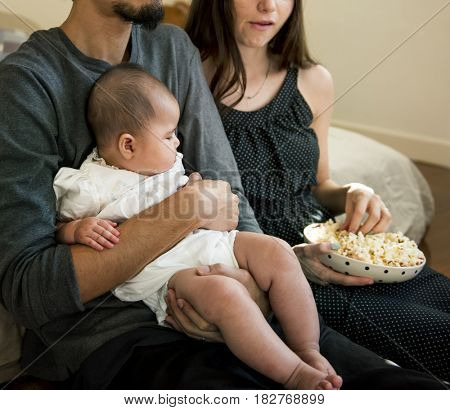 Family Relax Watching TV togetherness at Home