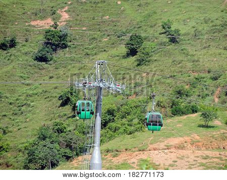 Cable car moving on the green hills