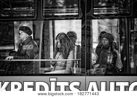 RIGA LATVIA - FEBRUARY 24 2016: Unknown people driving around the city by public transport. View through the window.