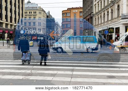 RIGA LATVIA - OCTOBER 14 2016: Double exposure. Abstract picture of urban rush and busy.