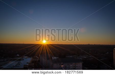 sunset in maryland over the city landscape