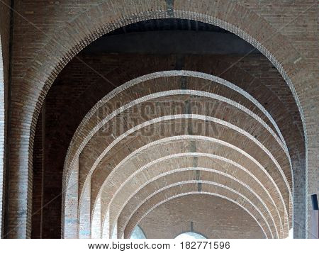 Long corridor formed by many brick arches