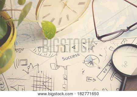 Magnifier and clock on the documents background