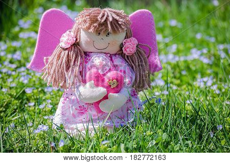 Doll made by hand on a background of nature or limited white background