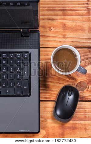 Flat Lay Overview Lap Top Computer With Mouse And Cup Of Coffee