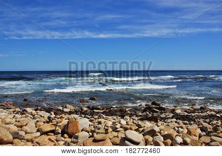 Beach full of stones next to Cape of Good Hope, Cape Town, South Africa.