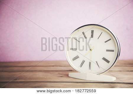 Modern clock on table in the office