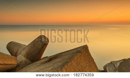 Sunset in the sea near the city of Ventspils breakwater