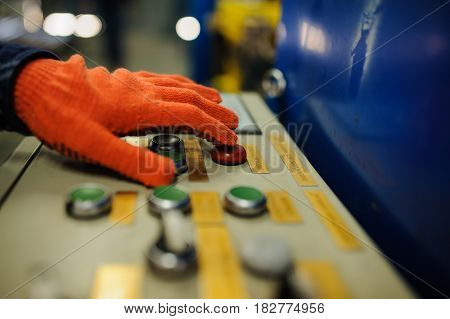 Operator Hand At Metal Roof Forming Machine