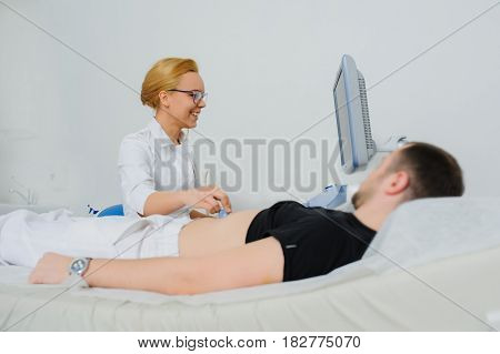 Smiling female doctor ultrasound examine a patient abdomen at the hospital. USG poster