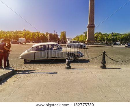 Vintage car against the Obelisk, the Concorde Square, Paris, France. Champs Elysees. PARIS, FRANCE, APRIL 2014