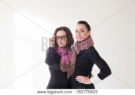 two girls cuddling a laughing glasses kardegan