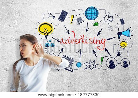 Young woman not able able to hear on concrete background with colorful sketch. Advertising concept