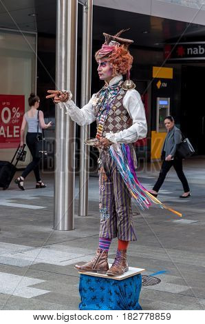 ADELAIDE, AU - March 22, 2017: Street performer entertains afternoon shoppers at Rundle Mall, Australia's first pedestrian mall.