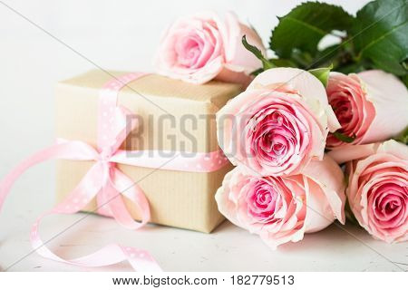 Pink rose and gift box. Mothers day postcard.