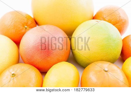 Fresh lemon, orange, mandarin, grapefruit, sweetie and pomelo fruits on white background. Flat lay, top view.