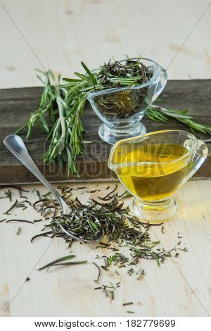 spice rosemary - fresh, chopped, oil in a glass jug