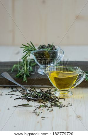 Olive oil with rosemary in a glass jug