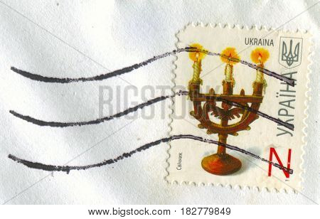 GOMEL, BELARUS, APRIL 20, 2017. Stamp printed in Ukraine shows image of  The candle is an ignitable wick embedded in wax, circa 2011.