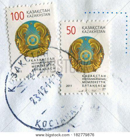 GOMEL, BELARUS, APRIL 20, 2017. Stamp printed in Japan shows image of  The emblem of Kazakhstan was adopted on June 4, 1992, circa 2011.