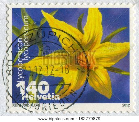 GOMEL, BELARUS, APRIL 21, 2017. Stamp printed in Swizerland shows image of  The tomato, Lycopersicon lycopersicum, was domesticated from a wild species that occurred in South America, circa 2012.