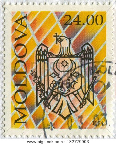 GOMEL, BELARUS, APRIL 21, 2017. Stamp printed in Moldova shows image of  The Coat of arms Moldova, circa 1994.