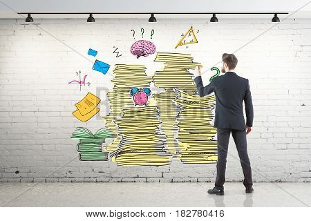 Back view of young businessman drawing creative paperwork sketch in white brick interior. Workload concept. 3D Rendering