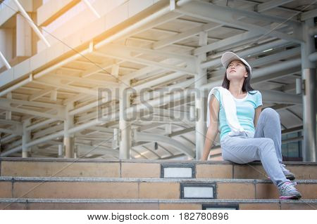 athletic young woman after training outdoors in the morning